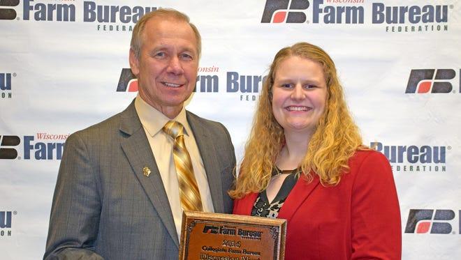 Farm Bureau President Jim Holte congratulates Sally Albers for wining the Collegiate Discussion Meet.