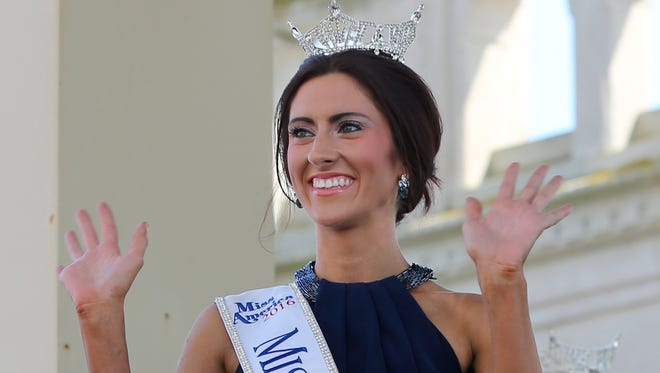 Miss Missouri Erin O'Flaherty waves as she is introduced during Miss America Pageant arrival ceremonies in Atlantic City. After competing in pageants for generations in the closet or working behind the scenes, gays and lesbians finally get to see one of their own take one of pageantry's biggest stages. O'Flaherty will compete for the Miss America crown as the first openly lesbian contestant.