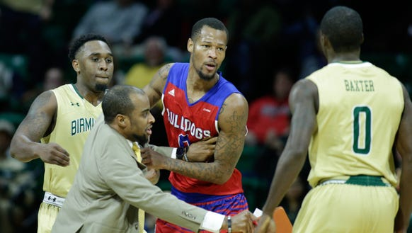 A UAB assistant coach holds back Louisiana Tech Bulldogs