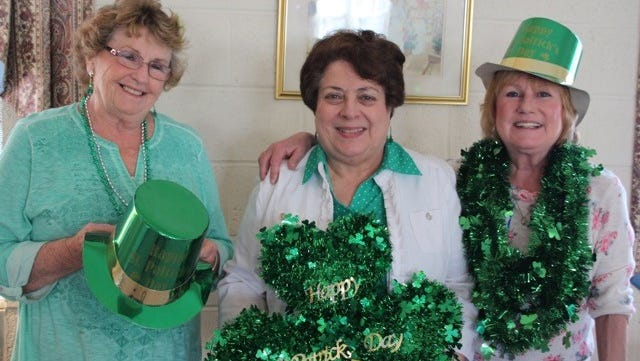 Millville Woman's Club recently held a St. Patrick's Day luncheon meeting. Barbara Morrow (left), Nuha Hababo (center), Donna Simpkins (right), Barbara Westog and Linda Green decorated the club house and coordinated the preparation of tasty Irish food.