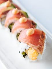 Shrimp tempura, jalapeno and cucumber topped with avocado,