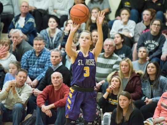 Lauren Lithgow (3) of St Rose shoots from the corner.