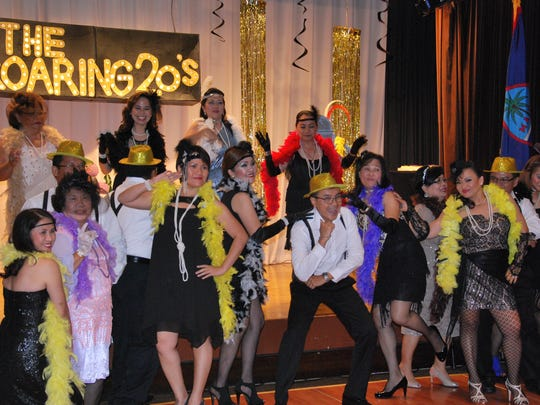 """Members of the Guam Stars Lions Club pose after their performance of """"Puttin' on the Ritz"""" during their 18th Anniversary celebration at the Westin Resort on July 18."""