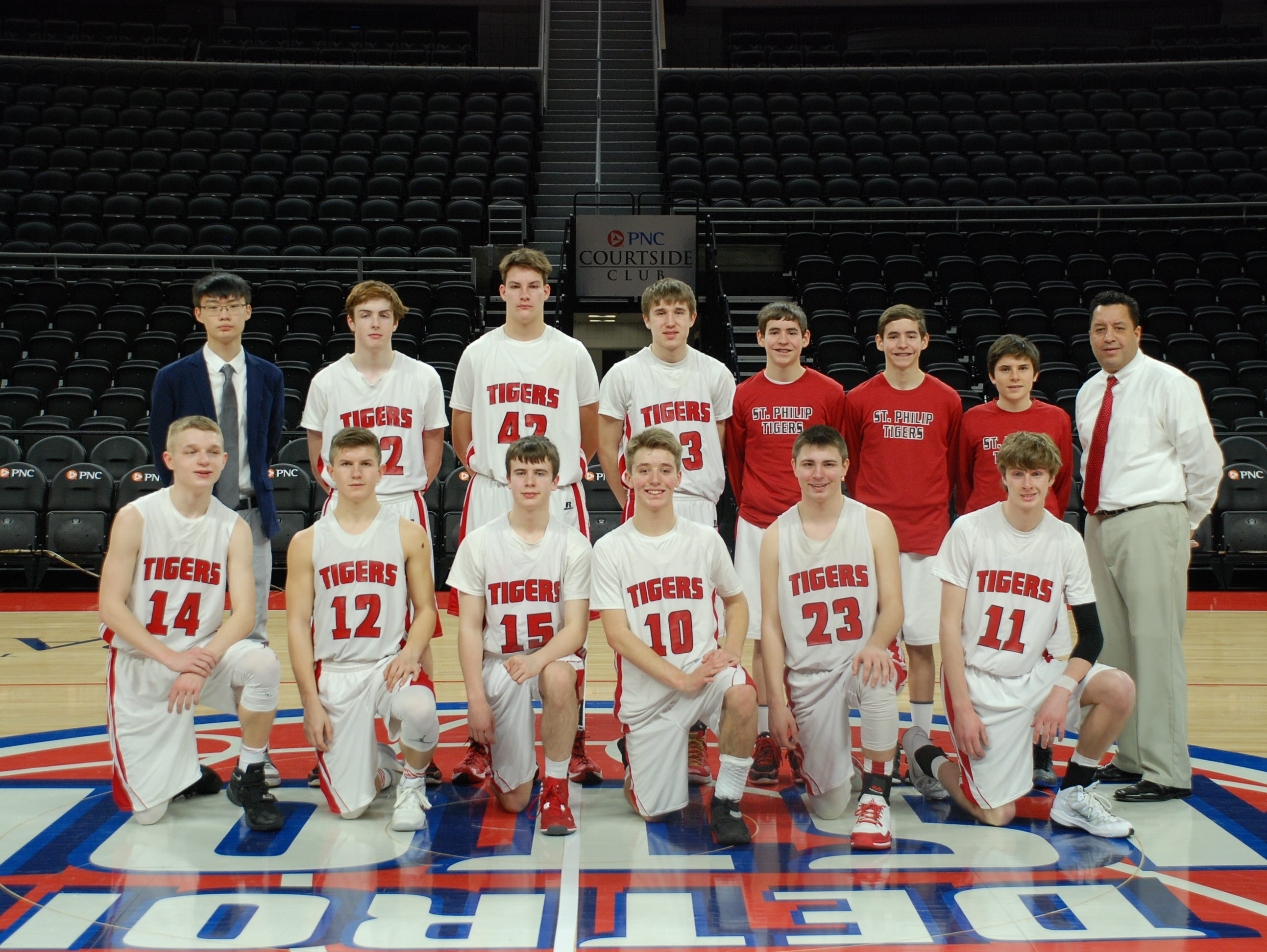 Members of the St. Philip varsity basketball team pose at center court after playing Bellevue at The Palace of Auburn Hills on Saturday.