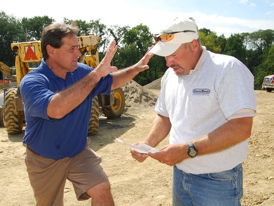 Kevin Schwartzhoff confers with Bob Griewe, Game Time sales representative, during the 2009 Clippard Park Boundless Playground build.