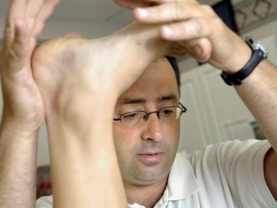 Larry Nassar, D.O., or Doctor of Osteopathy, works with a patient, July 15, 2008.