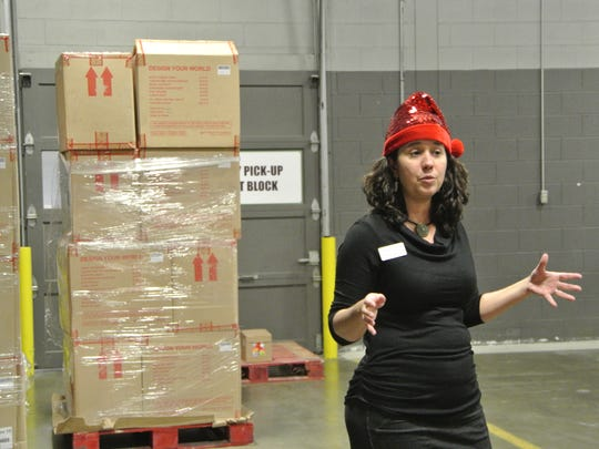 Food Bank of the Southern Tier President and CEO Natasha Thompson walks Steuben County officials and community leaders through the food bank's warehouse on Dec. 19, 2017.