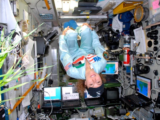 Anousheh Ansari floating upside down on the International Space Station during her trip to space in 2006.