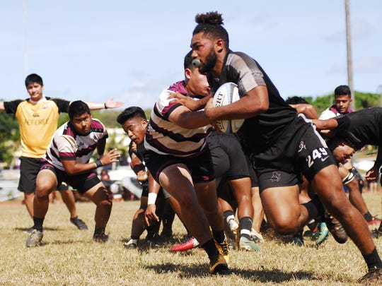 Simon Sanchez Sharks WIllie Booker scrambles for yardage during the boys championship game for high school rugby on Saturday March 10 at GW. The FD Friars won, 26-7.