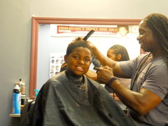 "Earl ""Everlasting"" Sanders, a Neptune barber who worked"
