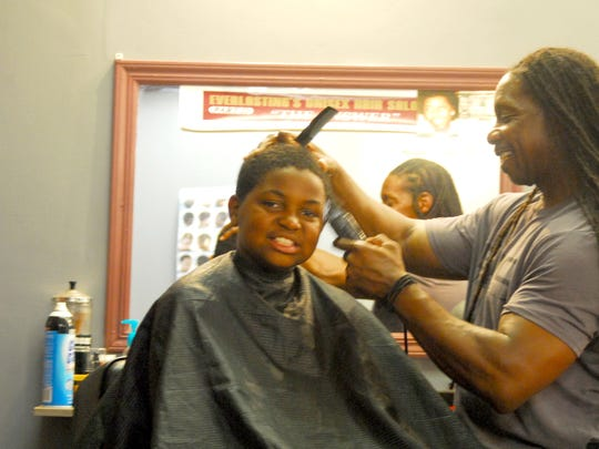 "Earl ""Everlasting"" Sanders, a Neptune barber who worked"