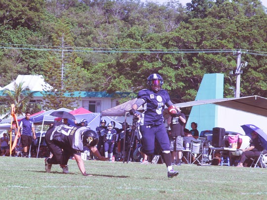 Island Stunnerz running back Mel Manglona eludes the last tackler on a breakaway run early in the third quarter of their Bud Light Guam Women's Tackle Football League game against the Steel Blazing Saints on Saturday, June 26 at the UOG football field.
