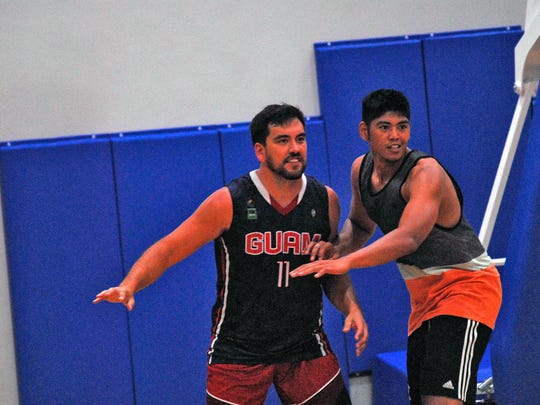 Seve Susuico, left, is guarded by Ben Borja during Team Guam practice at the Guam Basketball National Training Center in Tiyan on June 13.