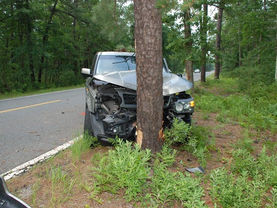 This Land Rover struck a deer and then a tree July