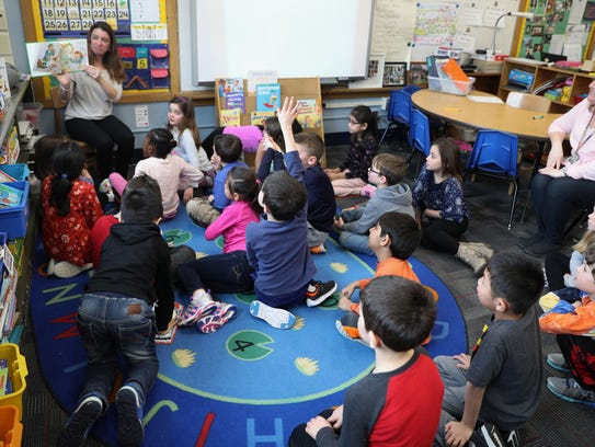 Rebecca Moore reads a book to her first-grade class