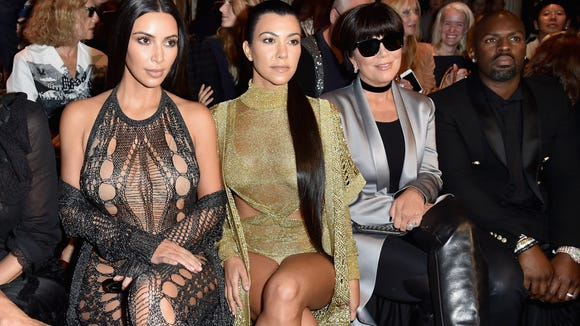 (Left to right:) Kim Kardashian, Kourtney Kardashian, Kris Jenner and Corey Gamble attend the Balmain show during Paris Fashion Week on Sept. 29, 2016.