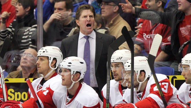 Detroit Red Wings head coach Mike Babcock reacts during the second period of a game against the New York Islanders.