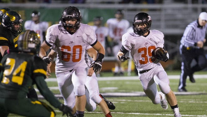 West Plains running back John Williams, right, returns to a Zizzers squad that went 7-2 in the 2014 regular season and shared the Ozark Conference championship with Camdenton.