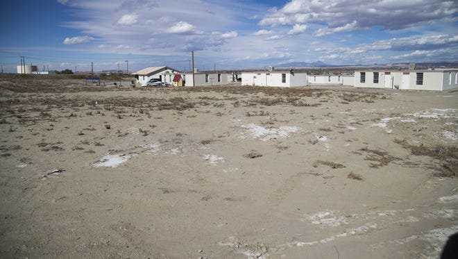 Vacant land dots a community in Shiprock, NM November 3, 2015. The Navajo Housing Authority built 91 homes here and problems with litigation and safety issues forced them to tear down 90 of them. Despite the NHA having over a quarter of a billion dollars of unspent grant money, many Navajos live in poor conditions.
