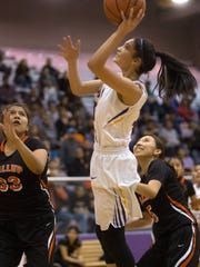 Kirtland Central's Talia Ockerman takes a shot against Gallup on Friday at Bronco Arena in Kirtland.