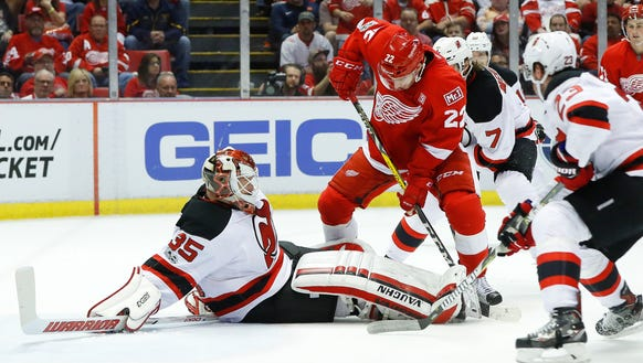 New Jersey Devils goalie Cory Schneider (35) stops