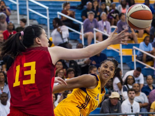 China's center Dong Yu (13) and Los Angeles Sparks center Candace Parker (3) battle for a loose ball during the first half of an exhibition women's basketball game, Saturday, May 10, 2014, in Los Angeles. (AP Photo/Ringo H.W. Chiu)