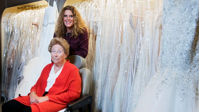 Long-time owner of The French Door Bridal Boutique Suzanne DeMore (left) poses for a portrait with new owner  Kalli Blackstone (right) in the shop on Sept. 20, 2017.