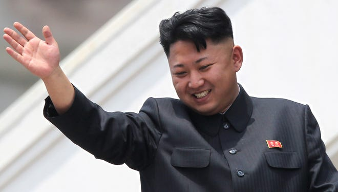 North Korea leader Kim Jong Un, shown in 2013, waves to war veterans during a military parade in Pyongyang.