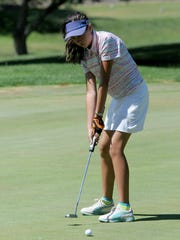 Kira Moore sinks a putt en route to posting the best overall score by a girl in the Richland County Junior Golf Tournament, which concluded Tuesday at Twin Lakes.