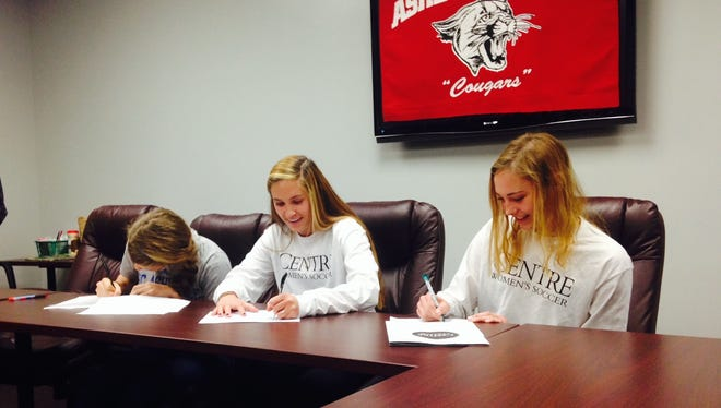 From left to right, Asheville High's Ellie Stone, Hannah Sirkin and Kathryn Ahearne have signed to play college soccer.