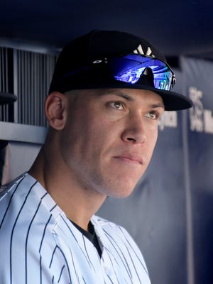 Yankees right fielder Aaron Judge watches from the bench during the first game of a doubleheader against the Cleveland Indians on Wednesday at Yankee Stadium.