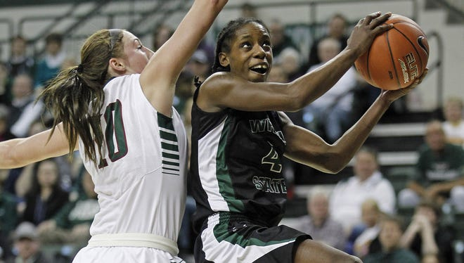 Wright State and Horizon League player of the year Kim Demmings, seen at right against UWGB forward Mehryn Kraker during the league tournament championship at the Kress Events Center in March, will return there for a rematch on Jan. 7.