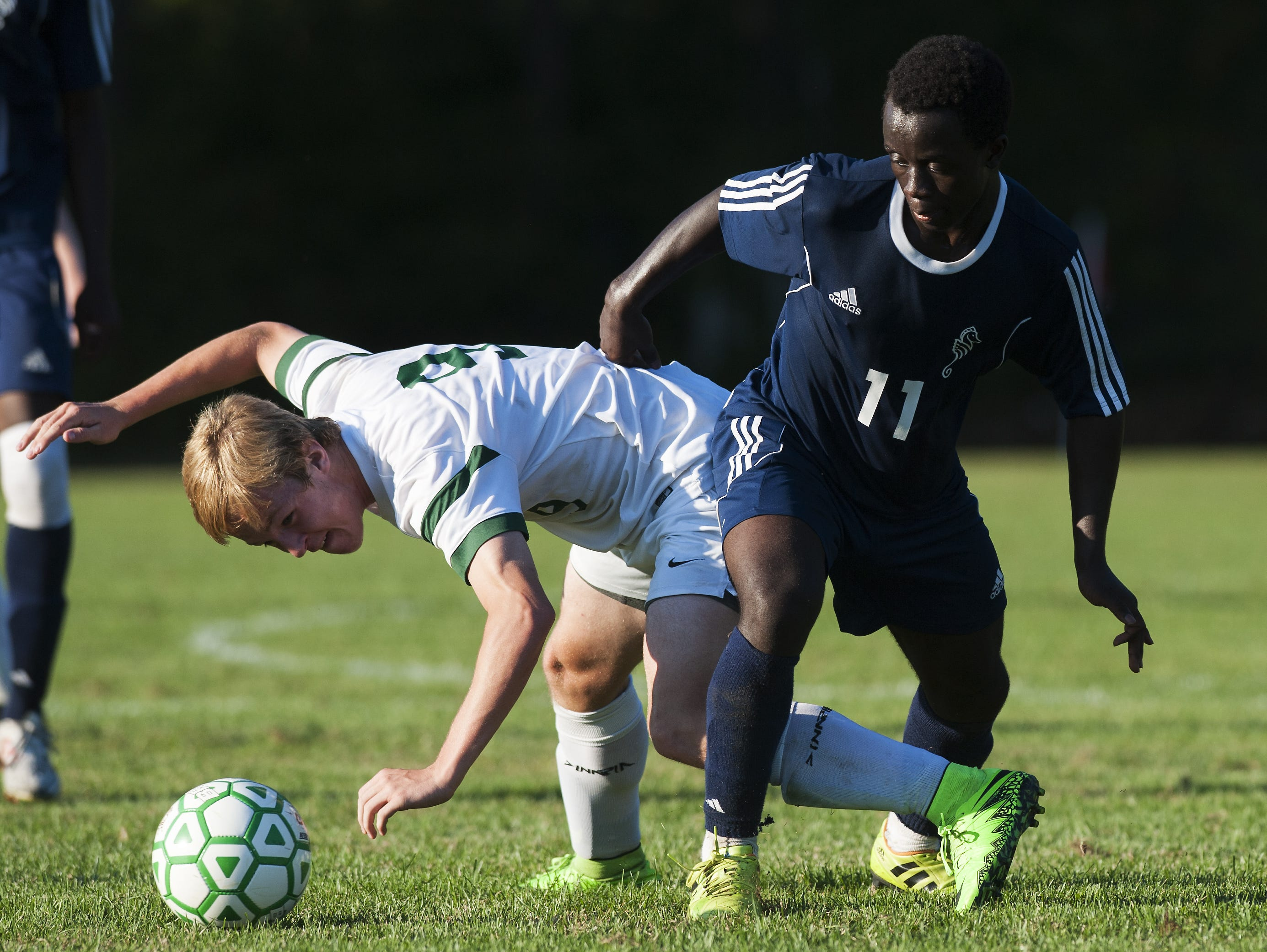 Rice's Nate Cary (9) and Burlington's Seraphin Iradukunda (11) battle for the ball during a high school boys soccer game against Rice on Tuesday.