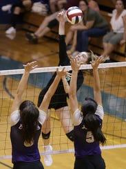 Montwood's Nadia Kern hits into Burges blockers Deandra