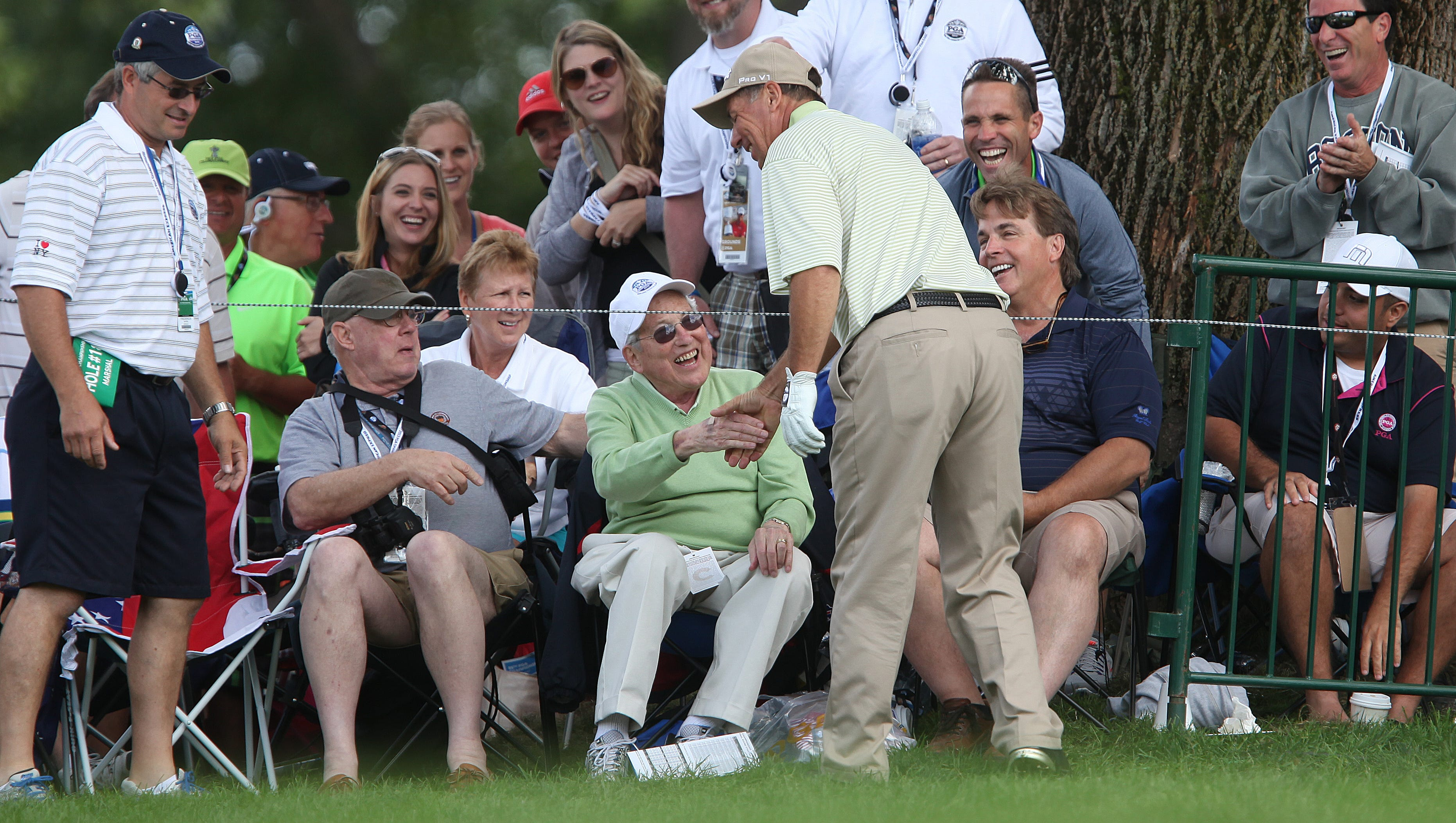 Rob Horack of Fairoport shakes hands with fans after his ball landed near them on 18 during the final round of the PGA Championship at Oak Hill Sunday.