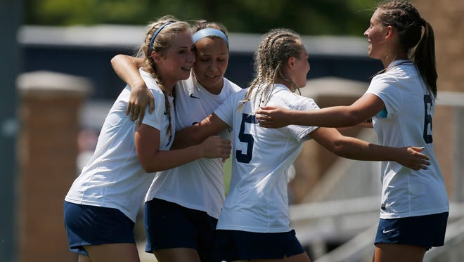 Players celebrate after Lewis Central freshman Grace Guidry (2) scored their opening goal against Newton Thursday, June 8, 2017, during the 2A girls state quarterfinals at the Cownie Sports Complex in Des Moines.