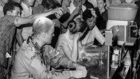 Tougaloo College professor John Salter, along with Tougaloo students Joan Trumpaeur and Anne Moody, take part in a sit-in May 28, 1963, to protest segregation at the Woolworth's in downtown Jackson, Mississippi. The gathering mob reacted violently, hitting them with fists and glass containers, and pouring mustard, flour, sugar and other things on them.