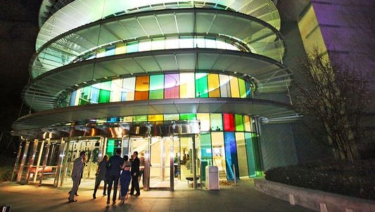 The Indianapolis Museum of Art shines at night.
