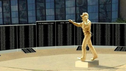 """A granite wall features the names of every player, assistant coach, trainer, manager and secretary who worked under James """"Boots"""" Donnelly."""