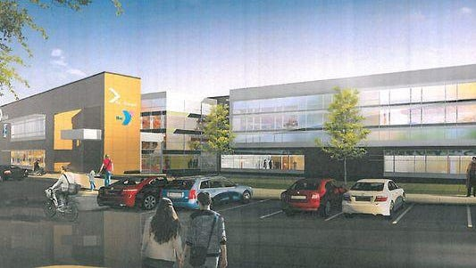A drawing shows an outside view of the planned St. Cloud Area YMCA community and aquatics center.