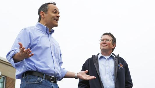 Then-gubernatorial candidate Matt Bevin speaks to a crowd of volunteers in Campbell County on Oct. 3 as U.S. Rep. Thomas Massie looks on.