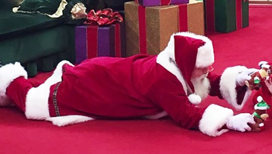 Caring Santa photo goes viral.