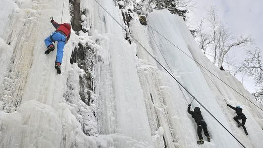 Climbers conquer frozen waterfalls at the Sandstone Ice Festival.