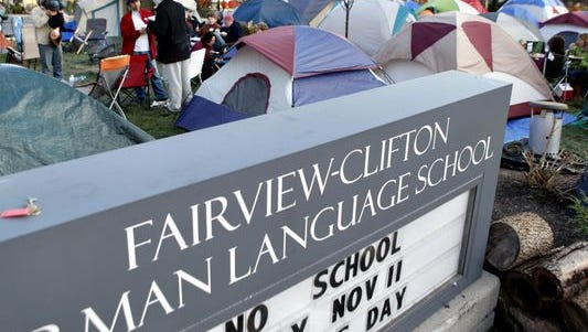 Parents camp out in front of Fairview-Clifton German Language School.