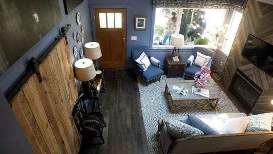 The living room of the HGTV Urban Oasis house in West Asheville is seen from the loft overlooking the open floor plan of the house.