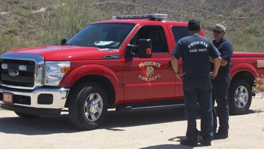 Officials called to a rescue are  shown on the Desert Vista Trail.