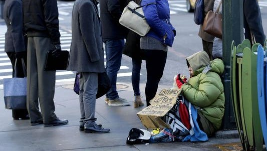 Family Promise of Northern Kentucky re-opened Monday after closing its doors two years ago. Pictured is a file photo of a panhandler in New York City.