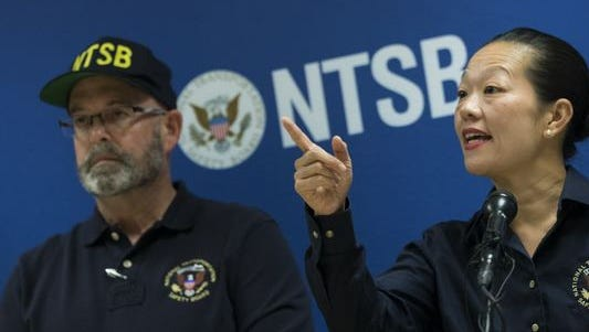 National Transportation Safety Board investigator James Southworth looks on as NTSB Vice Chairman Bella Dinh-Zarr speaks during a press conference near Hoboken rail station on Sept. 30, 2016, in Hoboken, New Jersey.