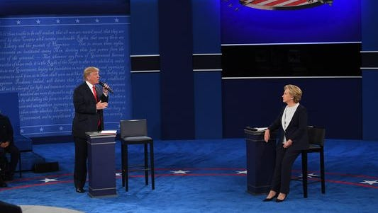 Hillary Clinton and Donald Trump take part in the second presidential debate at Washington University in St. Louis on Oct. 9, 2016.