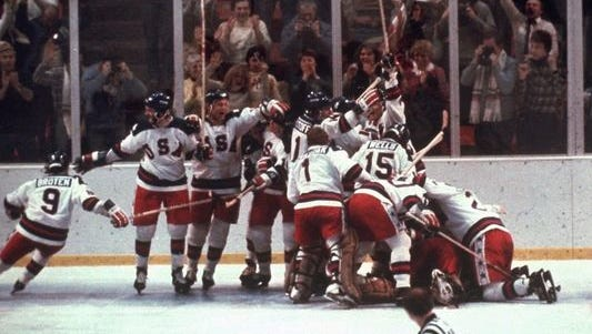 The U.S. hockey team pounces on goalie Jim Craig after the 4-3 'Miracle on Ice' victory against the Soviet Union in the 1980 Olympics on Feb. 22 in Lake Placid.